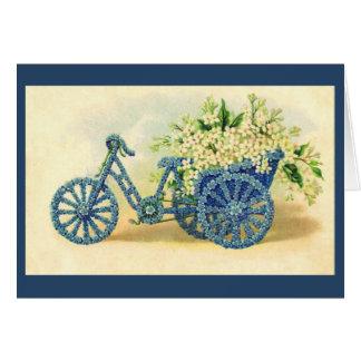 Tarjeta de felicitación floral azul del triciclo