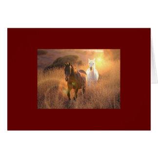 Tarjeta de felicitación galopante de los caballos