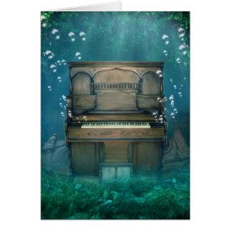 Tarjeta de felicitación sumergida del piano