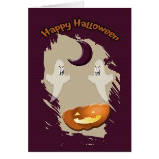 Tarjeta de Halloween con los fantasmas, la luna y