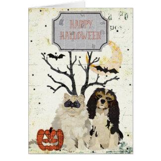 Tarjeta de Halloween del perro de aguas y del gato