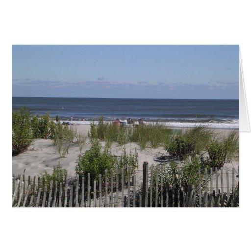 Tarjeta de la playa de la ciudad del océano