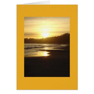 Tarjeta de la puesta del sol de Santa Cruz, océano