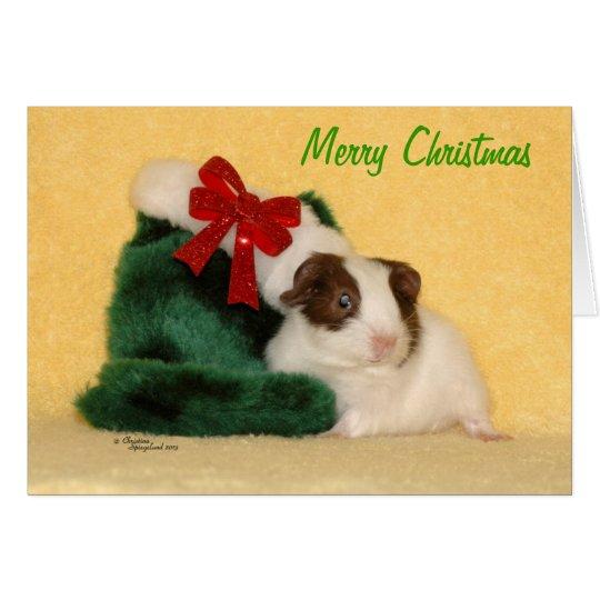 Tarjeta de las Felices Navidad del conejillo de