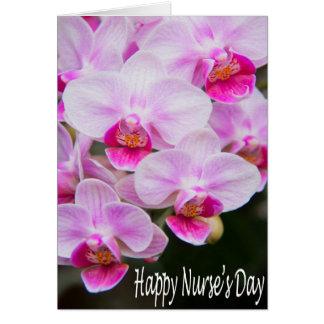Tarjeta de las orquídeas del rosa del día de la