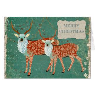Tarjeta de Navidad adornada ambarina de los ciervo