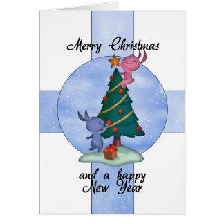 Tarjeta de Navidad con los conejos lindos que ador