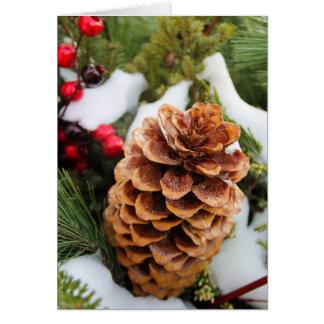 Tarjeta de Navidad con Pinecone y nieve