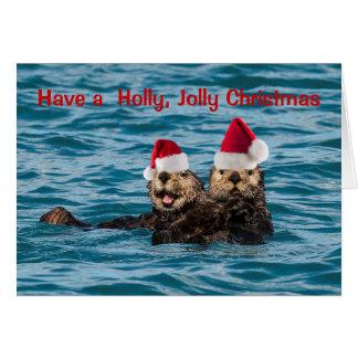 Tarjeta de Navidad de la fauna, nutrias que llevan