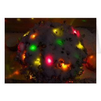 Tarjeta de Navidad de la nieve y de las luces