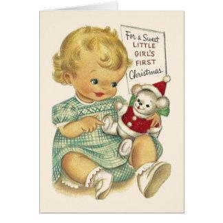 Tarjeta de Navidad de la niña del vintage primera