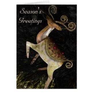Tarjeta de Navidad de oro del reno