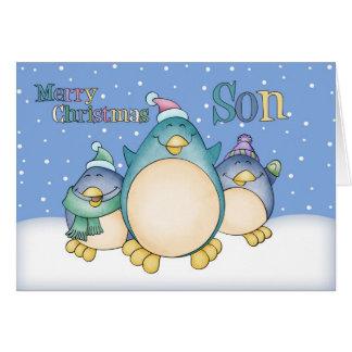 Tarjeta de Navidad del hijo con los pingüinos