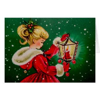 Tarjeta de Navidad del vintage con la chica joven