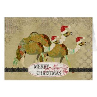 Tarjeta de Navidad soñadora de los camellos del vi