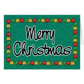 Tarjeta de Navidad verde de la gota del purpurina