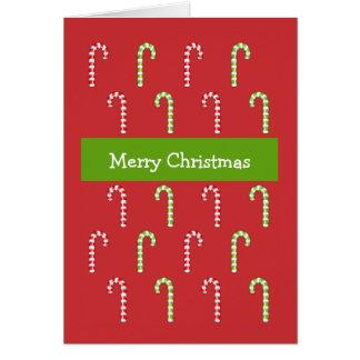 Tarjeta de Navidad verde roja de los bastones de c