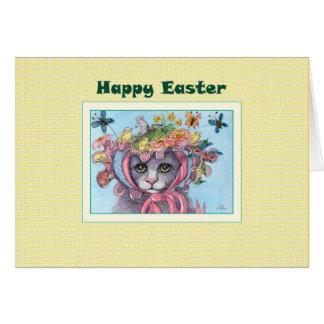 Tarjeta de pascua feliz, gato en un capo de Pascua