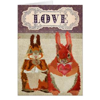 Tarjeta del amor de las ardillas rojas