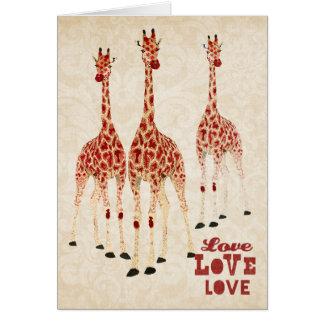 Tarjeta del amor de las jirafas del rosa rojo