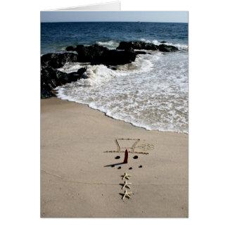 Tarjeta del día de fiesta del navidad de la playa