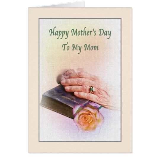 Tarjeta del día de madre con la biblia y las manos