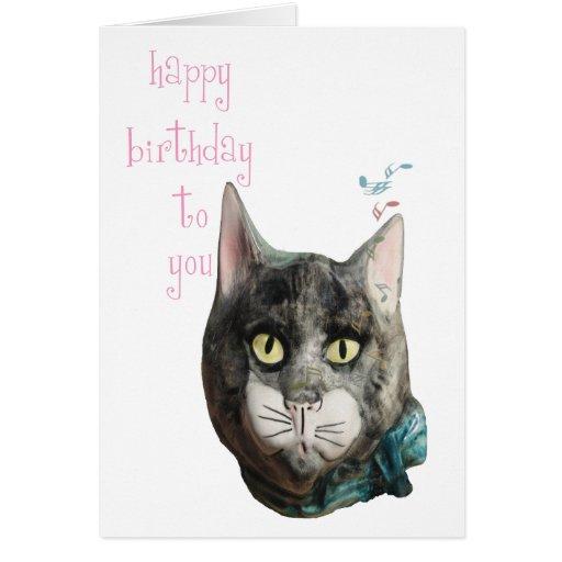 Tarjeta del feliz cumpleaños del gato que silba