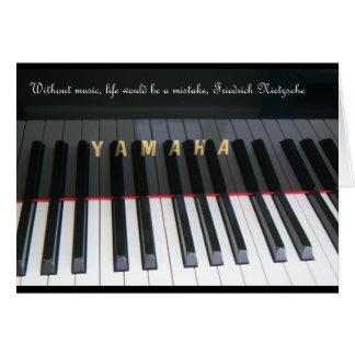 Tarjeta del piano con la cita de Nietzsche