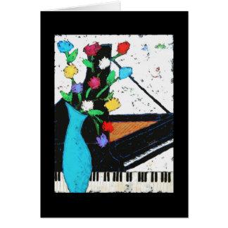 Tarjeta del piano y de las flores