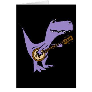 Tarjeta Dinosaurio divertido de T-rex que toca el banjo