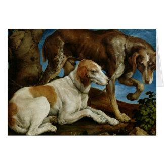 Tarjeta Dos perros de caza atados a un tocón de árbol,