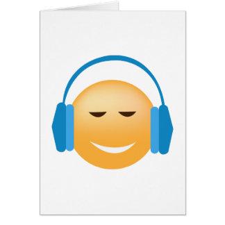 Tarjeta Emoji con los auriculares