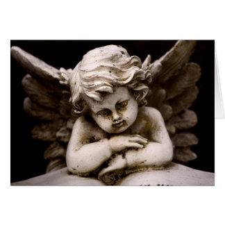 Tarjeta Escultura del ángel del Cupid que lee un libro