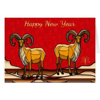 Tarjeta Espolón chino/cabra del Año Nuevo en rojos ricos