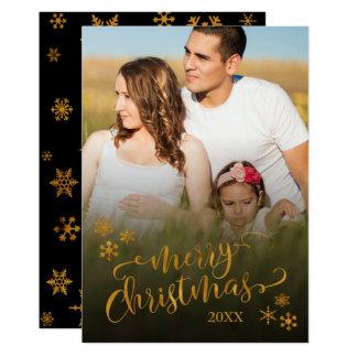 Tarjeta Felices Navidad del oro con la foto y los copos de