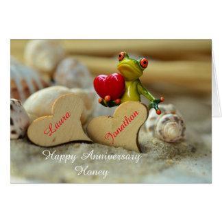 Tarjeta feliz del aniversario con la rana linda en