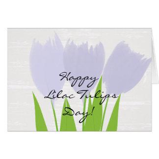 Tarjeta floral linda de los tulipanes de la lila