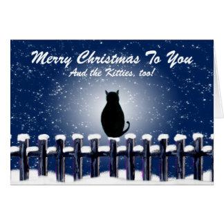 Tarjeta Gato en Felices Navidad de una cerca nevosa a