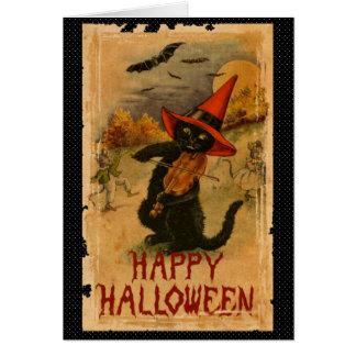 Tarjeta Gato negro del feliz Halloween que juega palos del