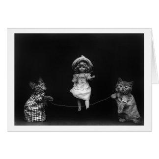 Tarjeta Gatos con la muñeca