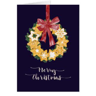 Tarjeta Guirnalda de la galleta del navidad con el fondo