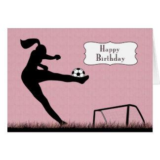 Tarjeta Jugador de fútbol del chica que golpea una bola