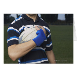 Tarjeta Jugador del rugbi con la bola