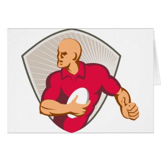 Tarjeta Jugador del rugbi que corre con la bola retra