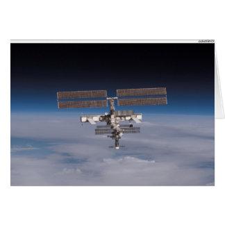 Tarjeta La estación espacial internacional en el horizonte