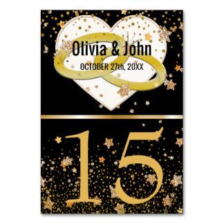 Tarjeta La tabla del boda numera el | los anillos de oro