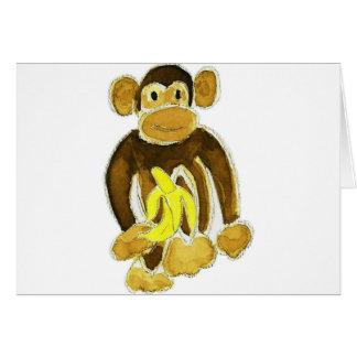 Tarjeta Mono que sostiene el plátano