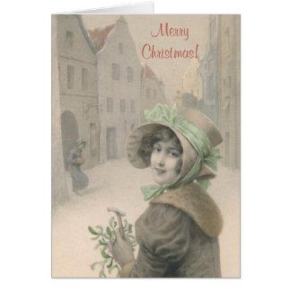 Tarjeta Navidad del chica y del muérdago del vintage
