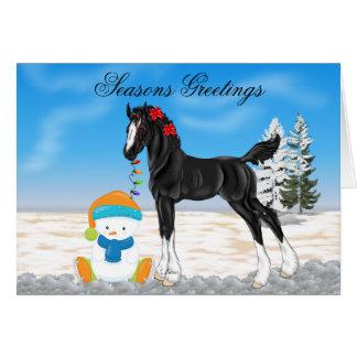 Tarjeta Navidad del potro y del muñeco de nieve de