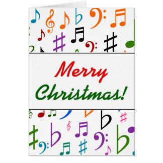 Tarjeta Navidad; Muchas notas y símbolos coloridos de la